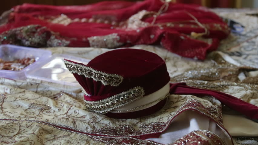 indian hat lays on indian cloths