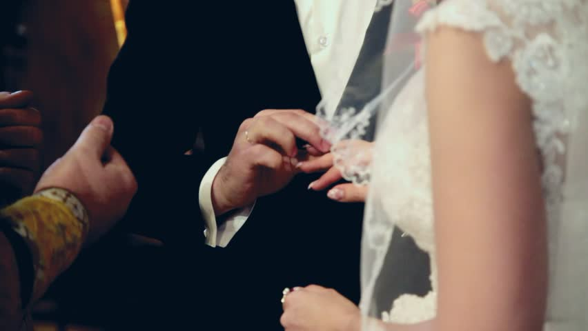 Stock Video Clip of bride and groom exchanging wedding rings