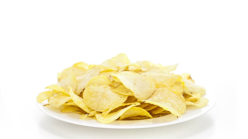 Potato chips rotating on the white table with white seamless background | Shutterstock HD Video #6770956