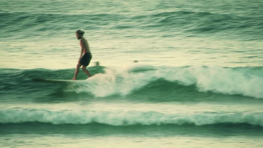 Australia 2012. Surfer riding a small wave on a longboard, carving, walking on the board etc | Shutterstock HD Video #6776236