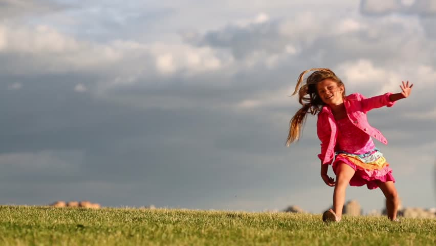 d7b241bdacb8 hd00 09Little happy girl does cartwheel at green meadow at cloudy ...