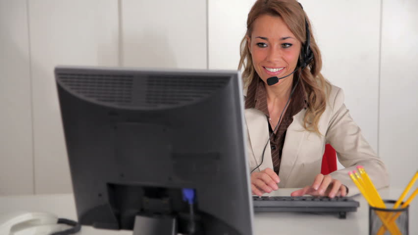 Mid adult female receptionist working on computer and speaking on mid adult female receptionist working on computer and speaking on the phone in office stock footage video 679006 shutterstock sciox Images