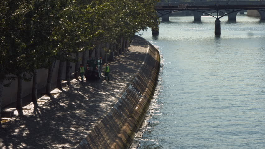 PARIS FRANCE- JULY 2, 2014: Paris' cleaning crew cleans the seine river bank | Shutterstock HD Video #6798886