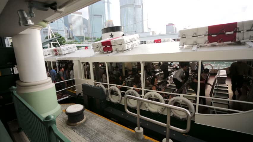 HONG KONG, CHINA - CIRCA JUNE 2014: Hongkong star ferry ready for shipment. Star Ferry Company is a passenger ferry service operator and tourist attraction in Hong Kong.    Shutterstock HD Video #6800944