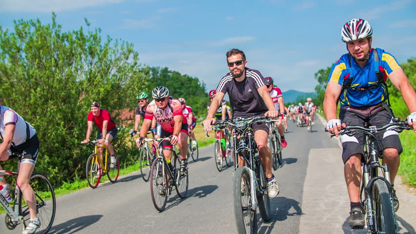 VRHNIKA, SLOVENIA - JUNE 2014: Bicycle marathon competition around Vrhnika. Hundred of bicycle competitors in slow motion | Shutterstock HD Video #6806653