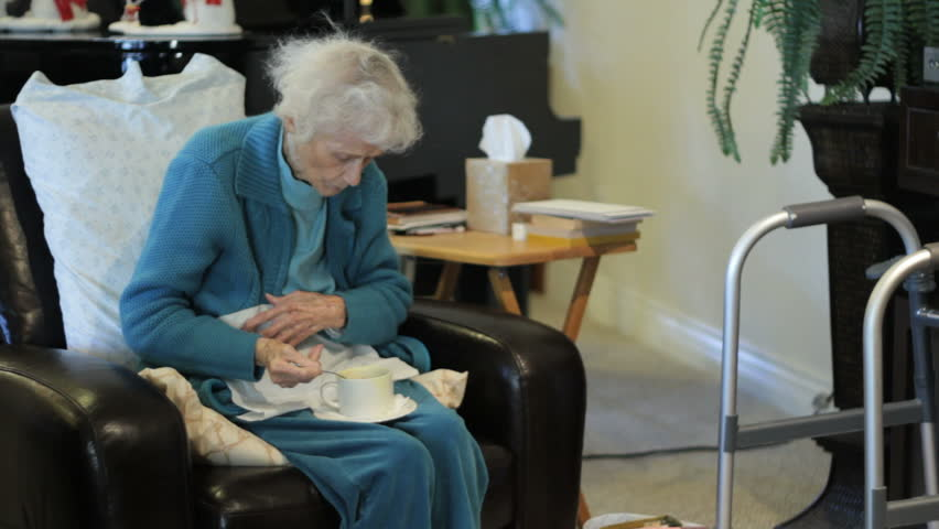Elderly Woman Eating Soup