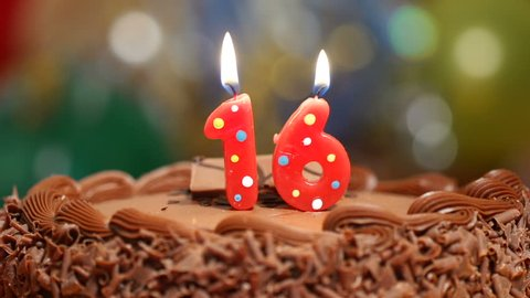 Candles on a cake are blown out for a 16th birthday - sixteen years old