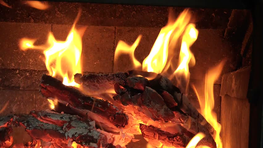 A Jib Shot Of A Hot Wood Burning Fire In A Living Room Fireplace ...