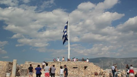 Greek Flag flying in the wind at the Acropolis, Athens, Greece
