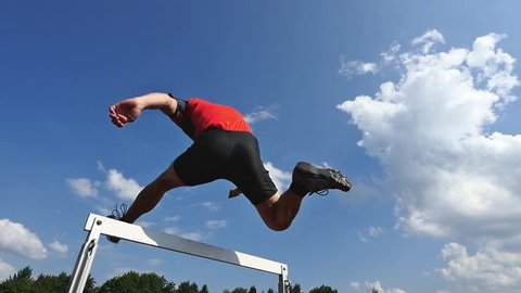 hurdling in track and field in slow motion