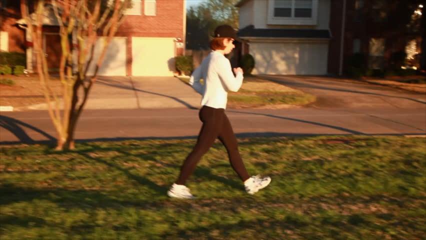d090a13c4ba4f A Woman Enjoying a Brisk Stock Footage Video (100% Royalty-free ...