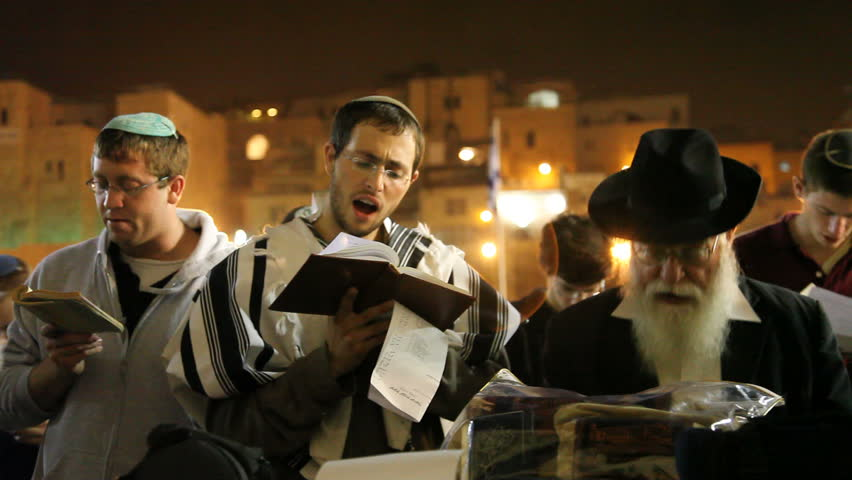 JERUSALEM, ISRAEL – SEP 18: Midnight prayers are reciting Slihot (penitential prayers) and imploring until Yom Kippur at the Western Wall, September 18, 2009.