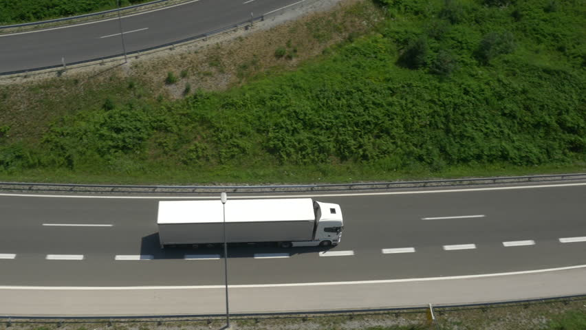 AERIAL: Truck driving along the freeway