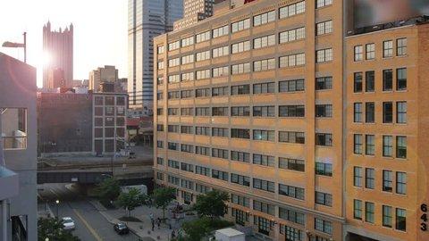 An establishing shot of downtown Pittsburgh at dusk.