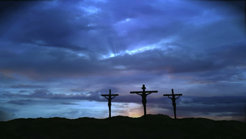 Three crosses with dark clouds
