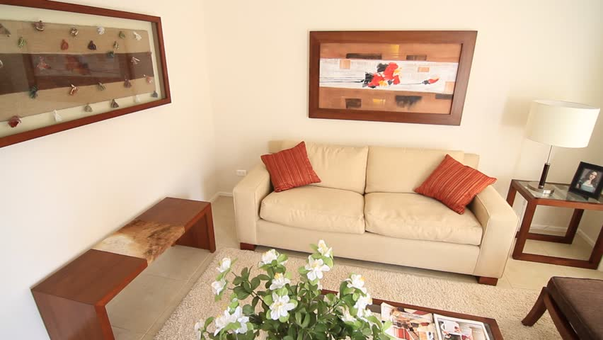 SANTIAGO, CHILE - INTERIOR LIVING ROOM - A Beautifully Decorated Living  Room Is Furnished With A White Couch And Two Living Room Chairs With Brown  Cushions ...