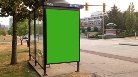 Coquitlam, BC, Canada - August 13, 2014 : Green billboard for your ad on bus station in Coquitlam BC Canada.