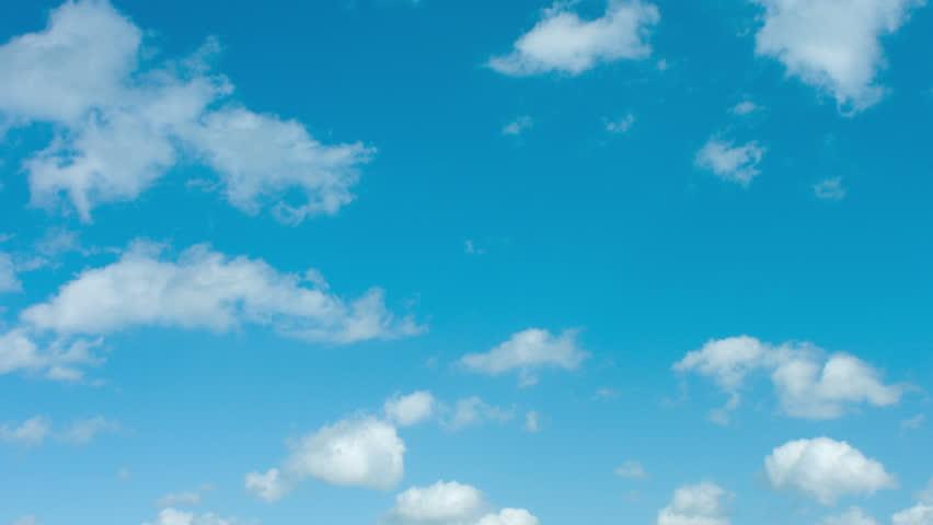 Clouds timelapse on blue sky, shot in RAW 4K UltraHD #7084426