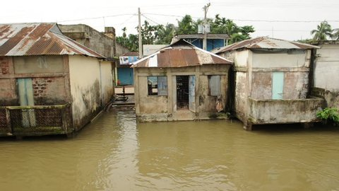 View of boat moving past flooded homes