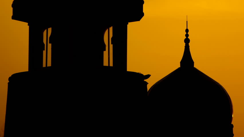 Silhouette of mosque, moving from bottom building to top.