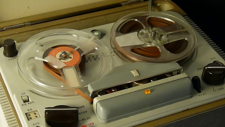 Playing a reel-to-reel tape on an old tube recorder.