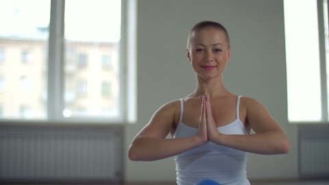 Close up of skinhead woman sitting in Pranayama