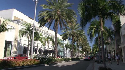 BEVERLY HILLS, CALIFORNIA – AUGUST 25 2014: Cars drive by on the expensive street of Rodeo Drive in Beverly Hills