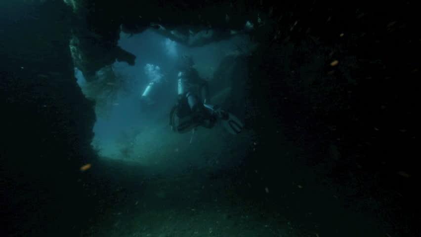 Scuba divers penetrating deep inside the Liberty shipwreck underwater in Tulamben, Bali | Shutterstock HD Video #7239616