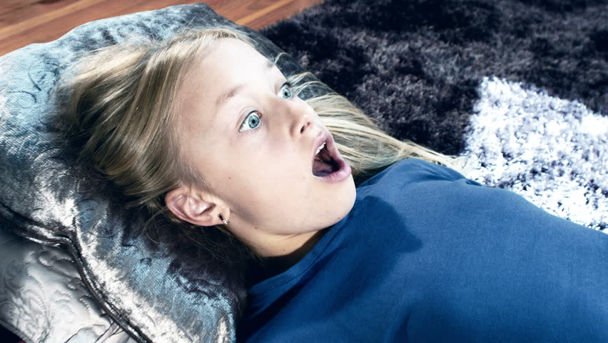 Scared And Surprised Girl Watching Scary Horror Movie In Tv, Shot In Raw Stock Footage Video -1789