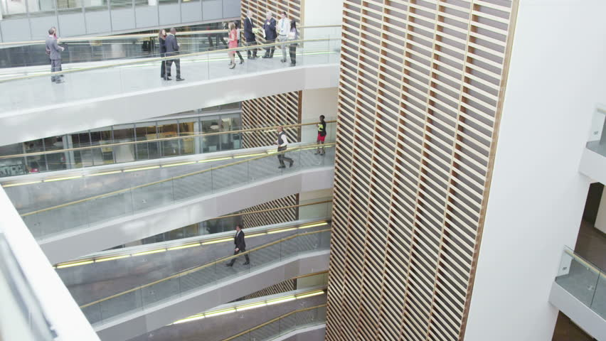 Business people walking along different floors of large modern office building | Shutterstock HD Video #7265266