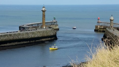 Harbor entrance at the port of Whitby on the North Yorkshire coast in northeast England.