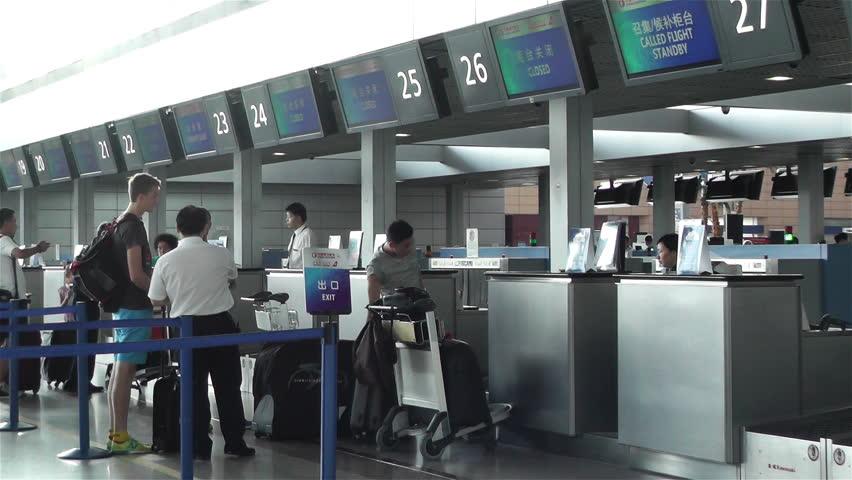 SHANGHAI, CHINA - JUNE 15 : Shanghai Pudong International Airport Interior in 2014   Shutterstock HD Video #7307164
