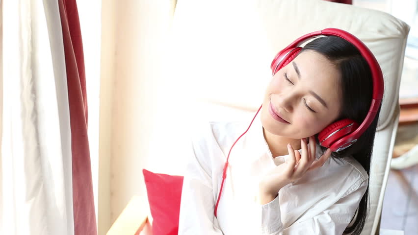Image result for woman listening to music