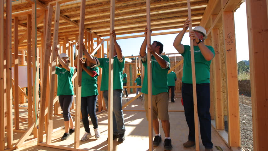 Volunteers working together lifting wall | Shutterstock HD Video #7333003