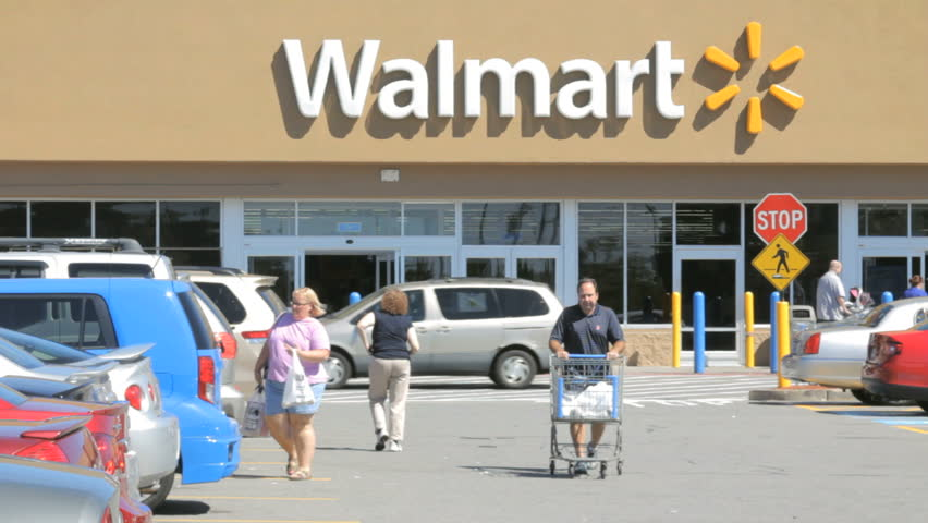 SEEKONK, MA - SEPT 14: Walmart store building exterior open for business on September 14, 2014. Walmart is the world's largest public corporation and the largest retailer in the world.
