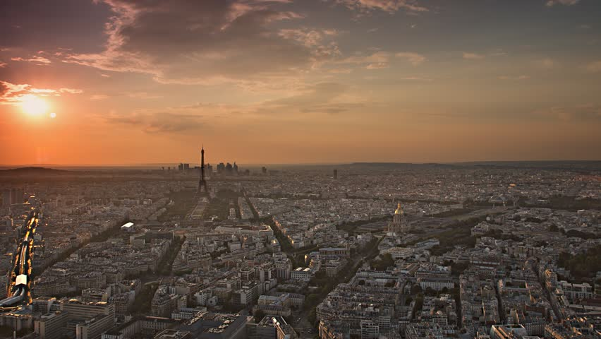 Paris skyline aerial day to night timelapse at the sunset to night city lighting up sparking eiffel tower panorama from montparnasse 4k