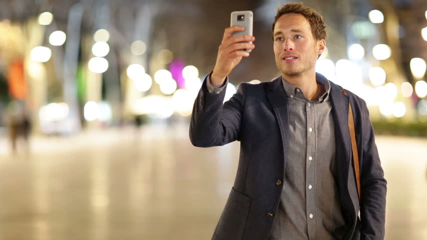 Smart phone Man taking photo with phone at night. Young casual professional business man taking picture with camera phone with flash on smartphone. | Shutterstock HD Video #7359766
