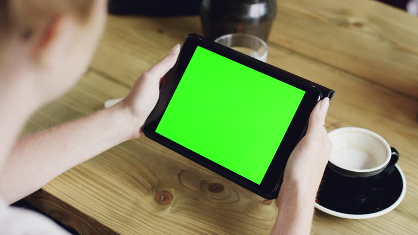 Green screen hands using digital tablet touchscreen device ipad in cafe holding tablet screen touchpad woman