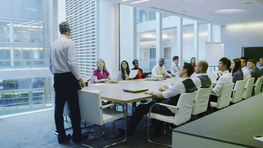 Business Team In Boardroom Meeting In A Large Modern