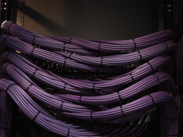This high definition footage is of a video server cables. The camera pans slowly down to reveal a organized video cable structure in PAL format. Other formats available