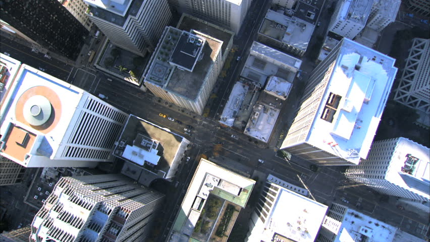 Aerial view looking down from above skyscrapers & city buildings of San Francisco, USA