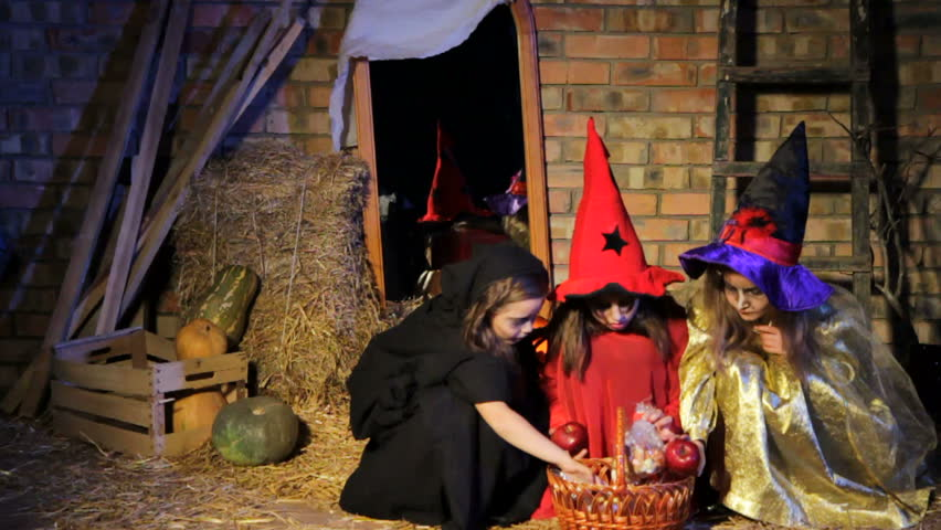 Children in costumes of witches for Halloween with presents see a ghost in a mirror and run away. | Shutterstock HD Video #7413556