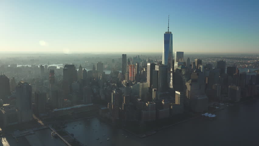 NEW YORK FREEDOM TOWER - CIRCA 2014:   NYC Financial District Sunrise on a perfect clear day. Float over the city in beautiful low light wide establishing aerials. Skyline shot in UHD 4K.