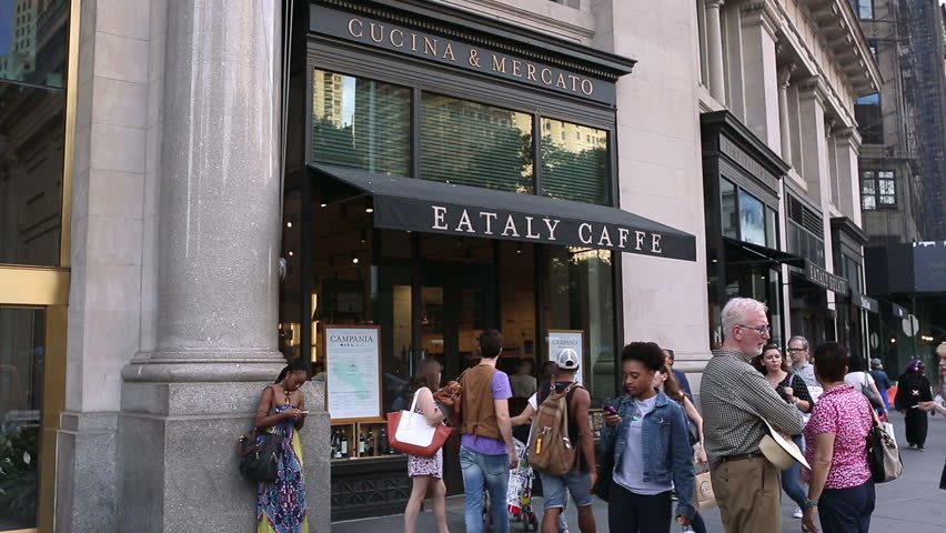 NEW YORK - SEPT 28, 2014: Eataly Caffe on crowded busy 5th Ave with tourists and people walking in Manhattan, New York City. Fifth Avenue is a major thoroughfare in Manhattan, NYC, USA.