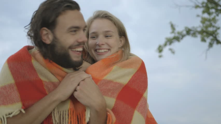 Couple wrapped in towel talking and laughing   Shutterstock HD Video #7489666