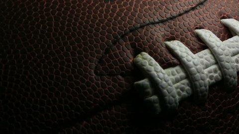 Slow panning shot of an american football