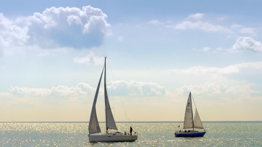 ENKHUIZEN, THE NETHERLANDS - AUGUST 30: Yachting in Markermeer lake on August 30, 2014. The racing of sailing boats is believed to have started in the Netherlands some time in the 17th century.
