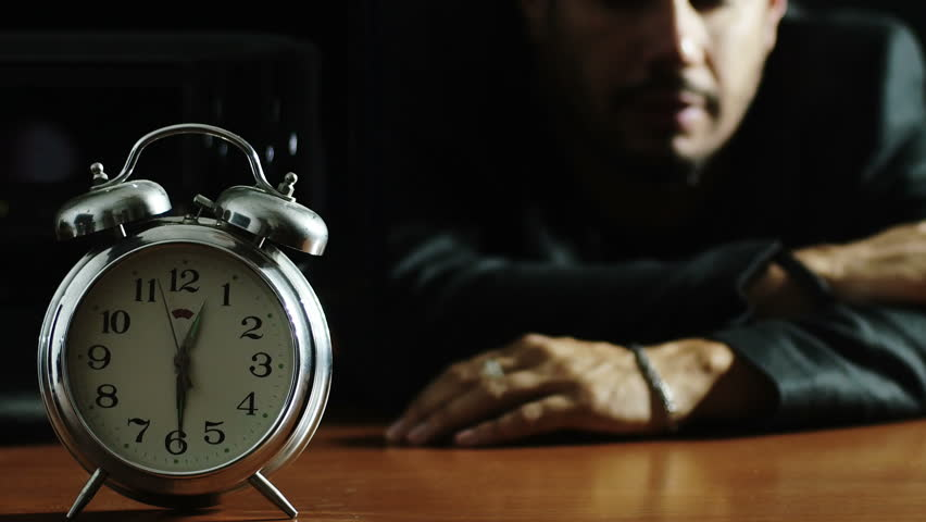 Restless man at night in bed trying to fall asleep stock footage depressed and tired man falls with the head on the table night loneliness ccuart Gallery