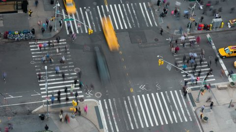 NEW YORK - MAY 7: (Time-lapse) Traffic and pedestrians move through Madison Square at the intersection of 5th Avenue and 23rd Street on May 7, 2014 in New York.