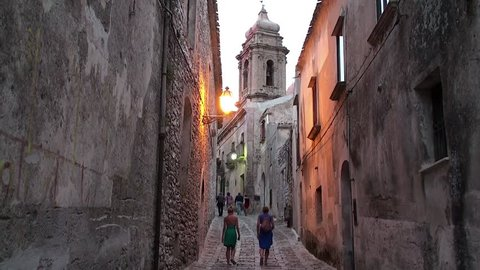 Tourists on the cobbled streets of the medieval Erice city. Sicily, Italy.
